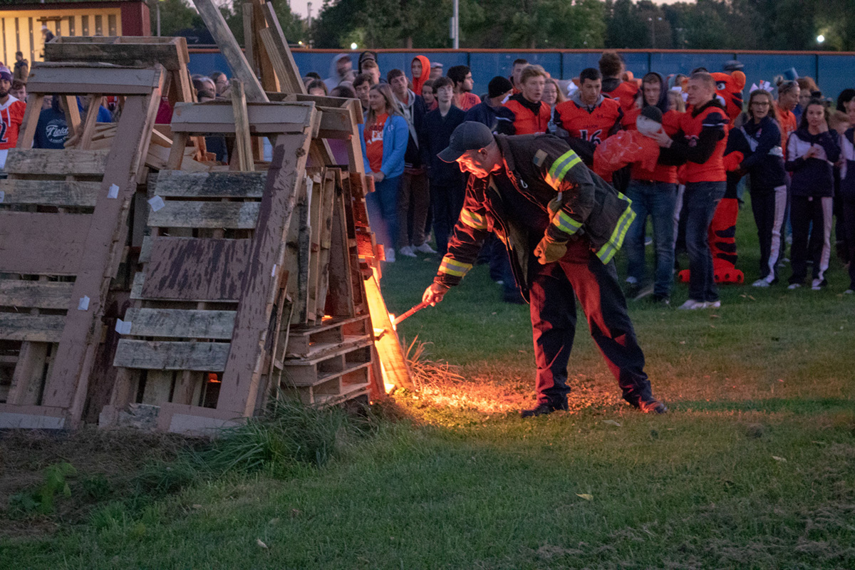 bonfire - fireman lighting it.jpg