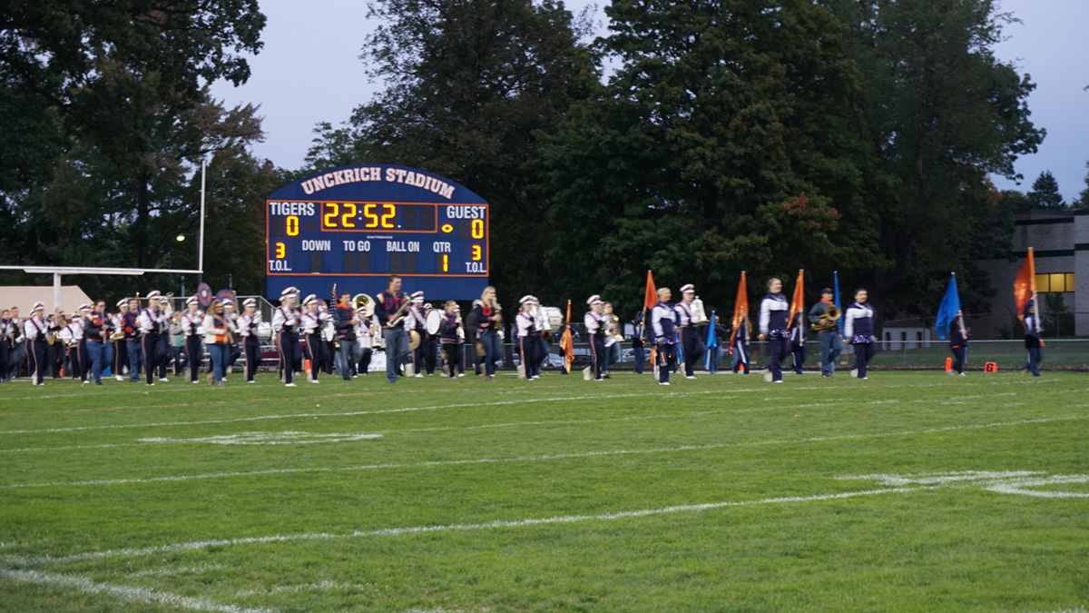 homecoming game - band marching down the field.jpg