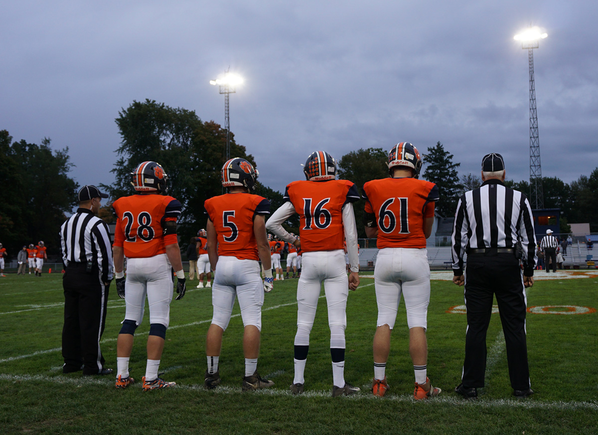 homecoming game - football captains ready for the coin toss.jpg