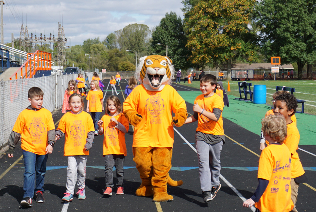tiger dash - 2nd graders run with tiger.jpg